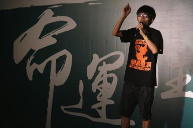 Joseph Wong at a rally hours before he was dragged away by police.