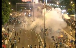 The Hong Kong police fires tear gas at unarmed protestors.