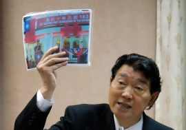 Representative Shen showing photos of the National Day celebration in 2013. Note the inclusion of the ROC flag